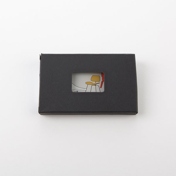 Top view of Eames 'Chair Designs' business card holder in packaging