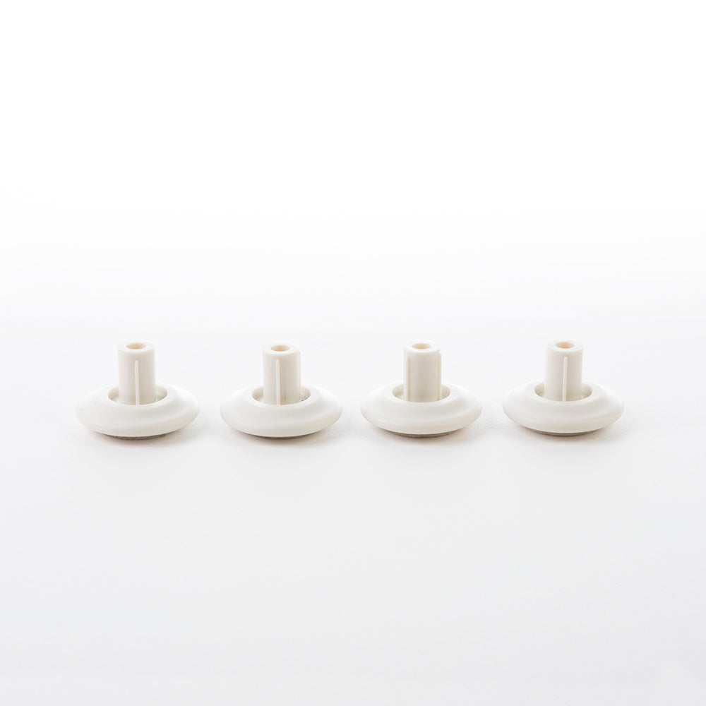 Image of full set of four white glides for Eames Office, Aluminium Lounge and Vitra Lounge Chair