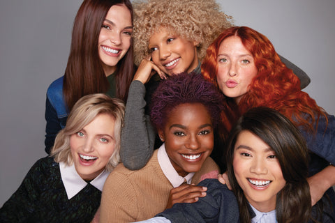 Paul Mitchell The Color Models posing in a group shot laughing and hugging