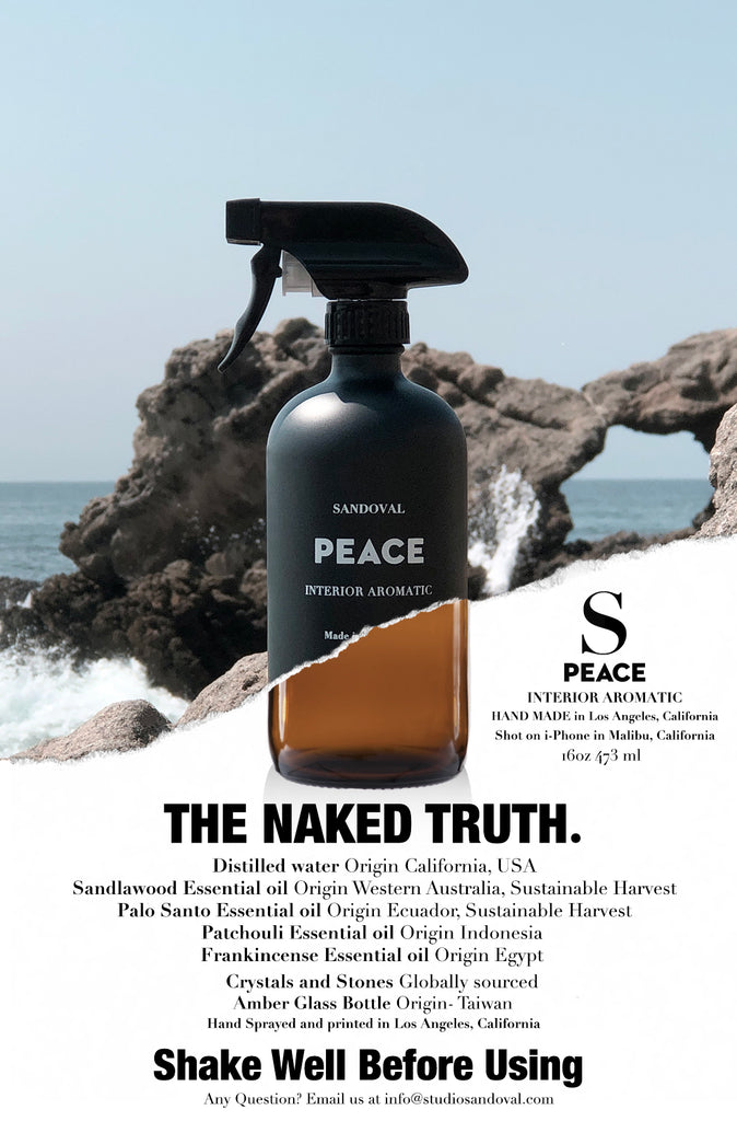 Peace Interior Aromatic.  The naked truth about Peace.  Black glass bottle sitting on top of an ocean side cliff in Malibu, California.  Made with distilled water and essential oils of palo santo, sandalwood, frankincense and patchouli.