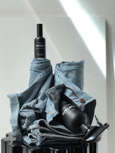 Captain Interior aromatic black glass bottle.  made with essential oils of lavender, bay rum, patchouli, sandalwood.  laundry refresh, room refresh. linen refresh.