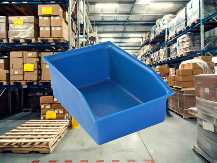 Warehouse packing with a blue Pioneer Plastics storage bin in the foreground