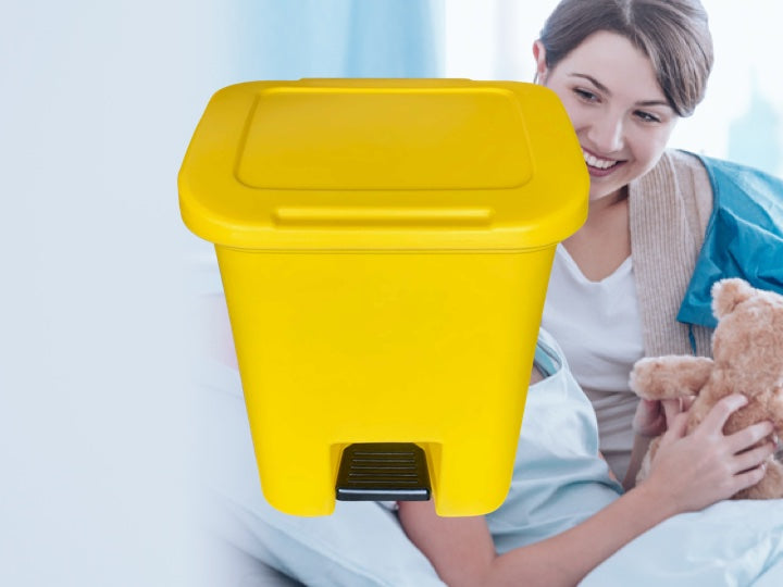 Hospital patients with a yellow Pioneer Plastics medical waste bin in the foreground