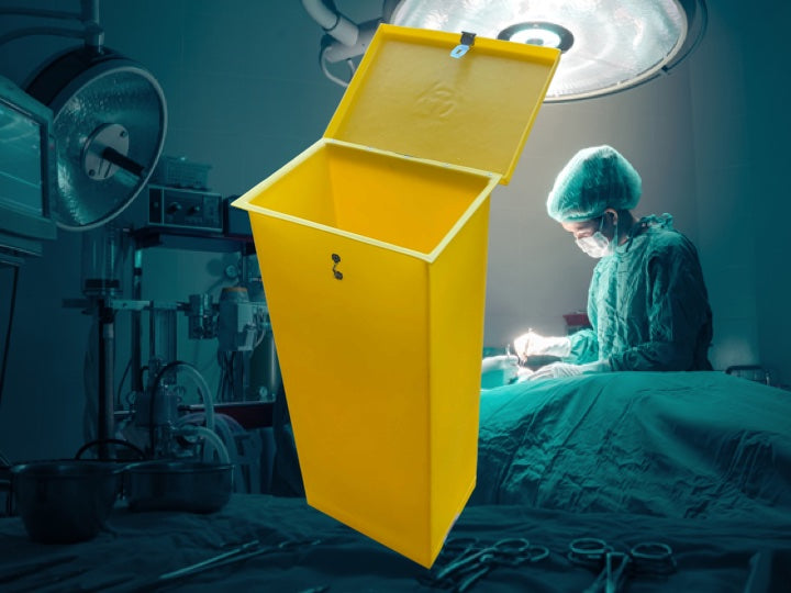 Surgery room with a surgery going on with a yellow Pioneer Plastics Medical waste bin in the foreground