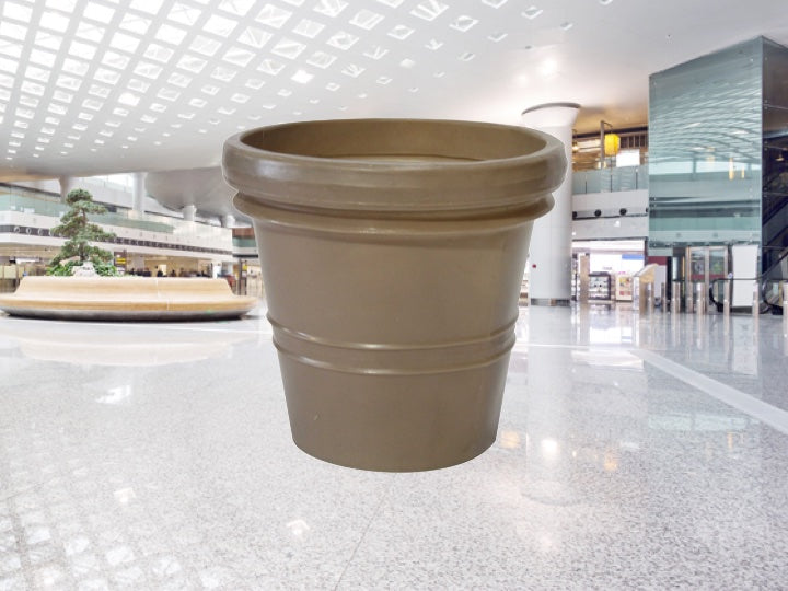 inside of a Shopping centre with a beige Pioneer plastics flower pot in the foreground