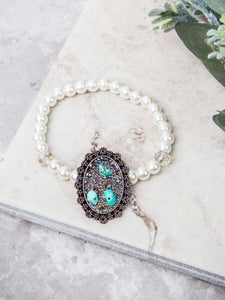Ornate Turquoise Stone Pendant on Pearl and Clear Beaded Stretch Bracelet