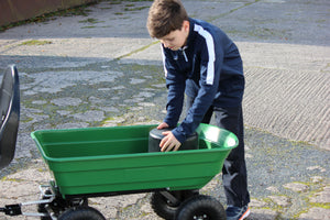 Plastic round silage bale toy in trailer