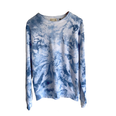 Blue hand dyed organic unisex tie dye crew neck jumper. Made from 80% organic cotton and 20% recycled polyester. Hand dyed to create bespoke designs. Irish owned sustainable brand