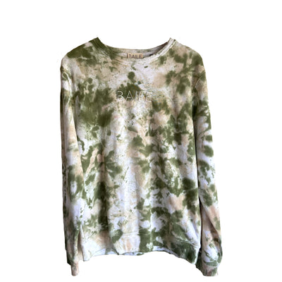 Green hand dyed organic unisex tie dye crew neck jumper. Made from 80% organic cotton and 20% recycled polyester. Hand dyed to create bespoke designs. Irish owned sustainable brand
