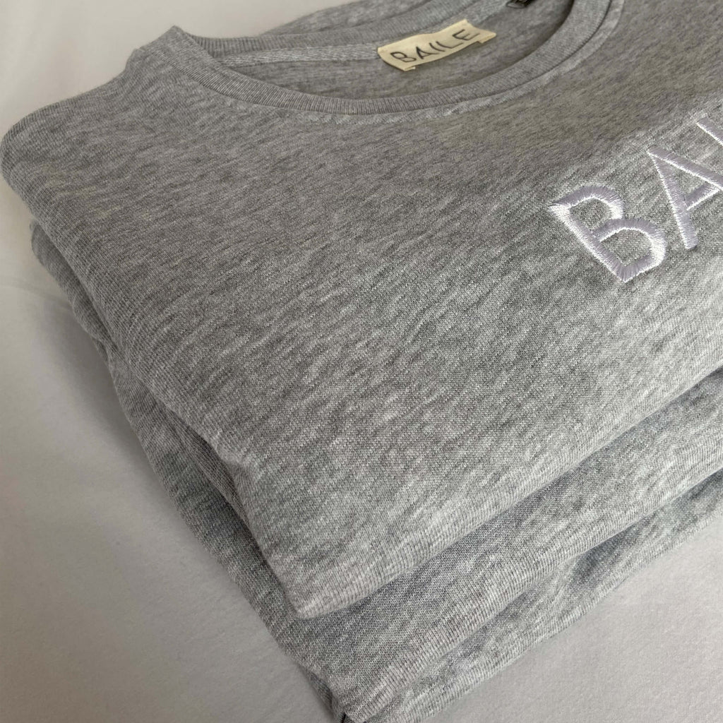 Grey  organic unisex crew neck jumper. Made from 80% organic cotton and 20% recycled polyester. Hand dyed to create bespoke designs. Irish owned sustainable brand