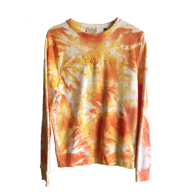Orange and yellow hand dyed organic unisex tie dye crew neck jumper. Made from 80% organic cotton and 20% recycled polyester. Hand dyed to create bespoke designs. Irish owned sustainable brand