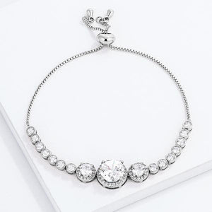 Adjustable Rhodium Plated Graduated Clear CZ Bolo Style Tennis Bracelet - Jewelry Xoxo