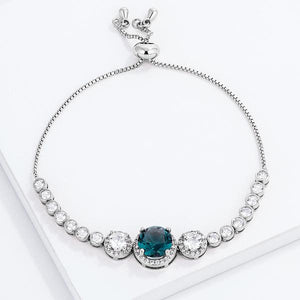 Adjustable Rhodium Plated Graduated CZ Bolo Style Tennis Bracelet - Jewelry Xoxo