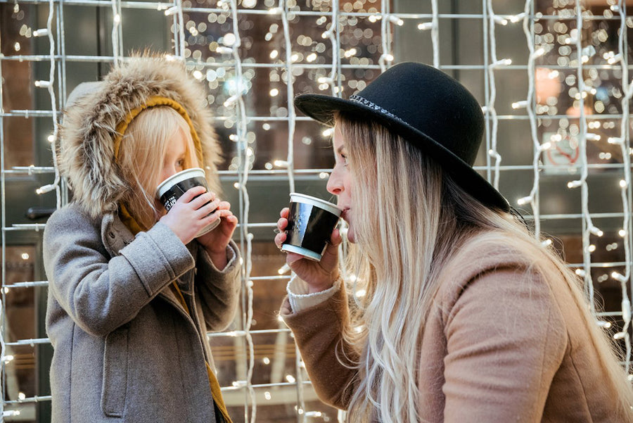 Mom and daughter having hot cocoa together