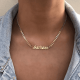 A woman wearing a personalized necklace