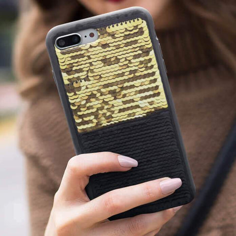 Woman holding a gold sequin personalized iPhone case