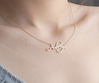 A woman wearing a custom name necklace