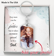 A silver personalized Keychain with a photo of a man and his daughter