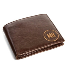 A men's custom wallet with the initials MH
