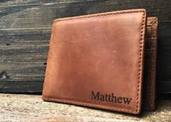 A personalized men's wallet with the name Matthew on it