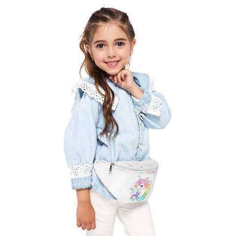 A little girl with a sequin fanny pack with a unicorn on it