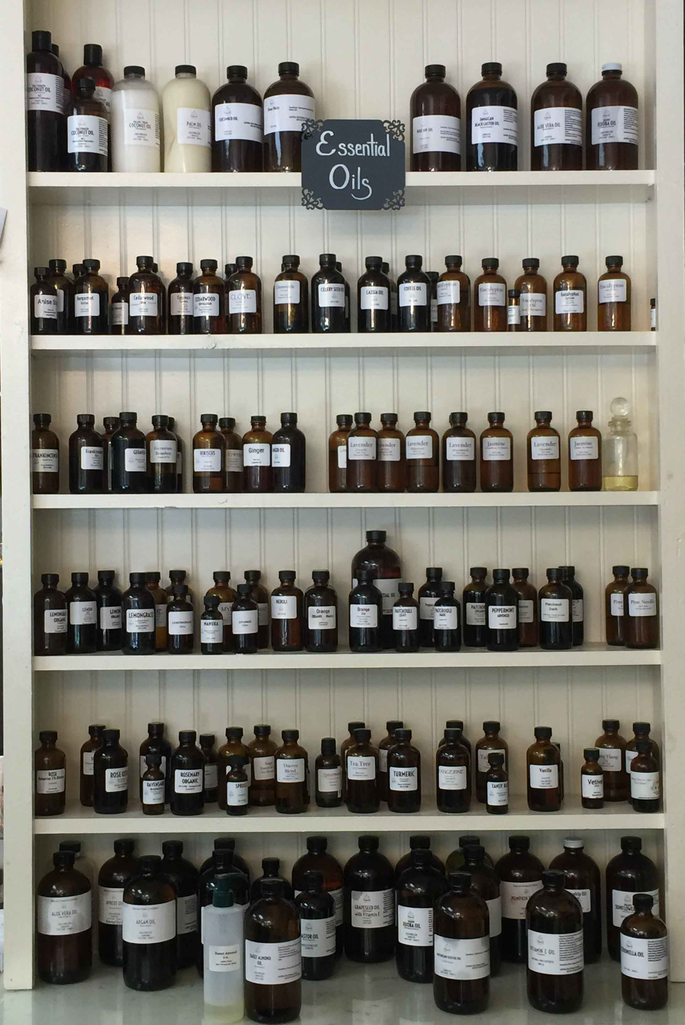 Shelf filled with Amber Bottles that carry essential oils