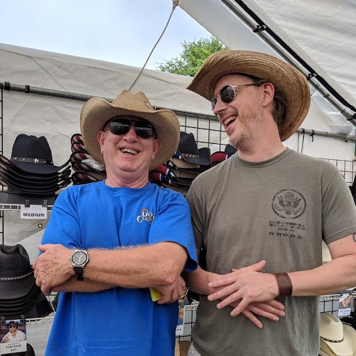 Keith and Chuck wear the same cowboy hat shaped differently.