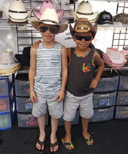 Too cute little boys in their cowboy hats
