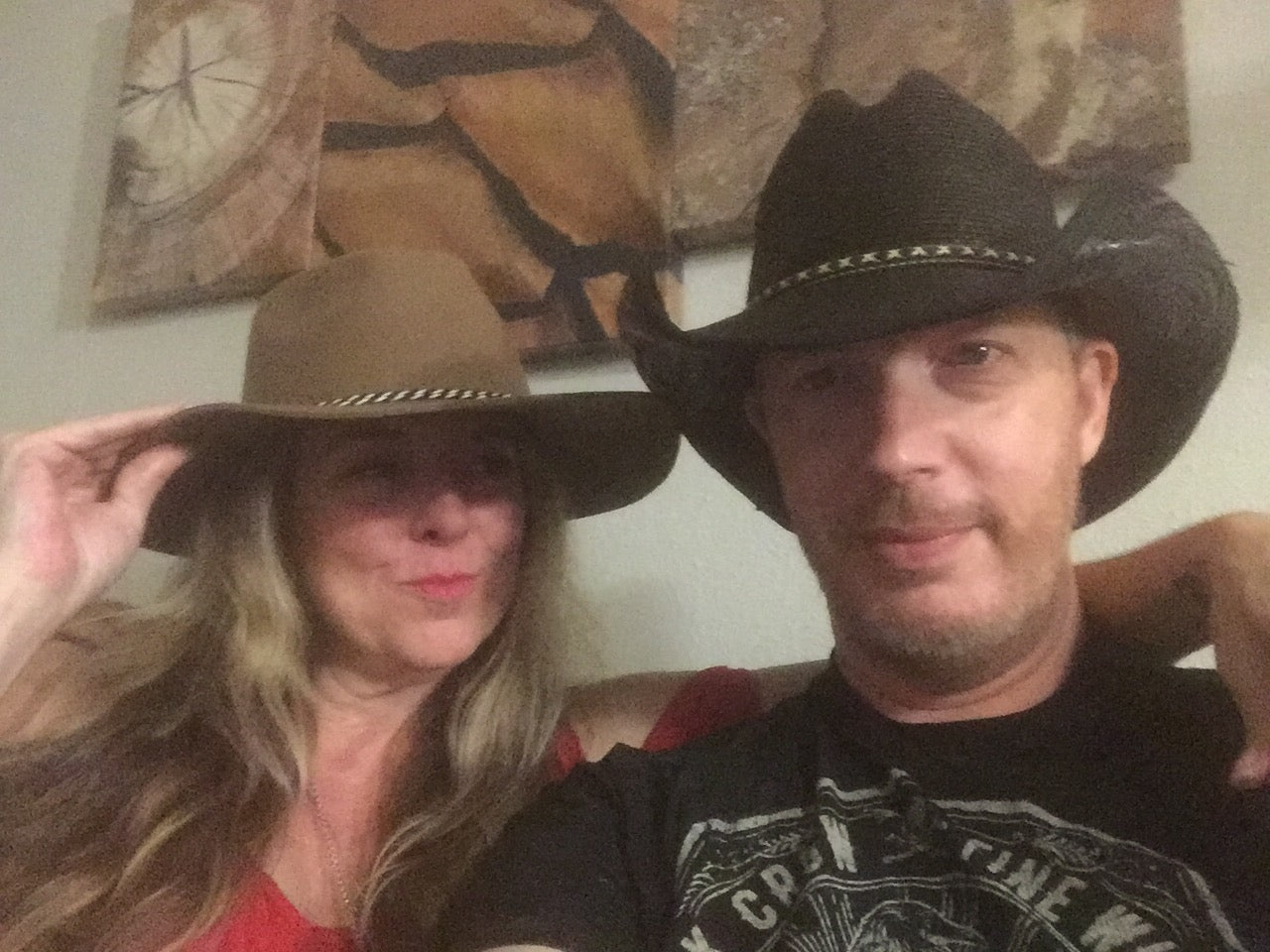 Chuck and Stephanie love Gone Country hats