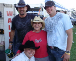 Judy and cowboys at Country Fest