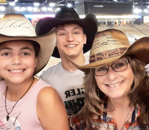 Randall and kids in Gone Country Hats
