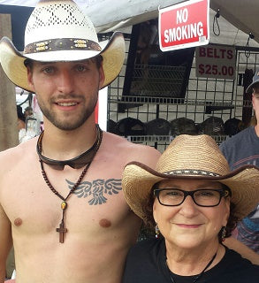 Judy and a customer in a cowboy hat