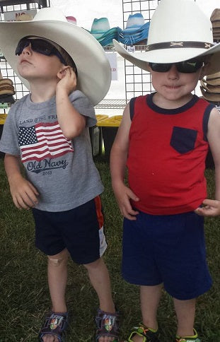 Adorable boys. you can custom size your cowboy hat?