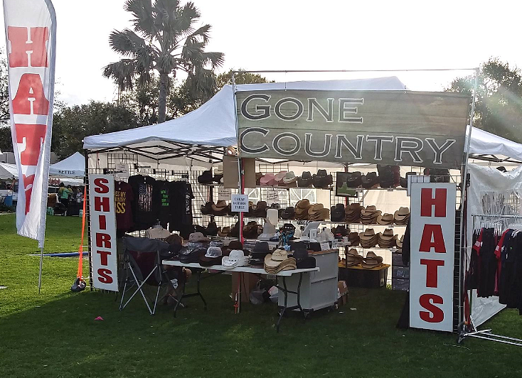 Gone Country cowboy hat store set up at a country music festival