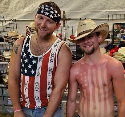 Sunburned guys in cowboy hats at Gone Country