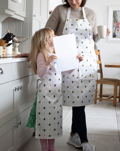 Children's oil cloth aprons. Kids aprons in our Bumble Bee homeware collection