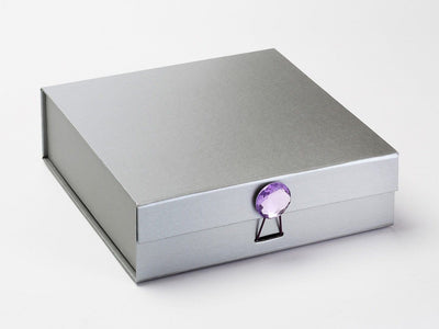 Silver Folding Gift Box Featuring Purple Sapphire Gemstone Closure