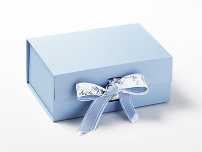 Animal Parade Ribbon Featured on Pale Blue Gift Box