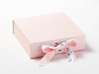 Animal Parade Ribbon Featured on Pale Pink Gift Box