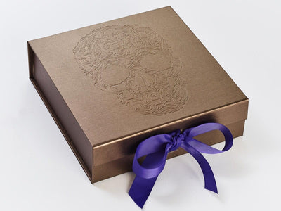 Bronze Folding Gift Box with Debossed Logo and Regal Purple Grosgrain Ribbon