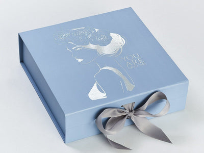 Example of Pale Blue Gift Box with Custom Silver Foil Logo and Silver Grey Ribbon
