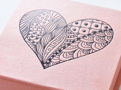 Example of rose gold gift box with black foil printed heart design