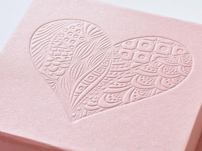 Example of rose gold gift box with debossed heart design