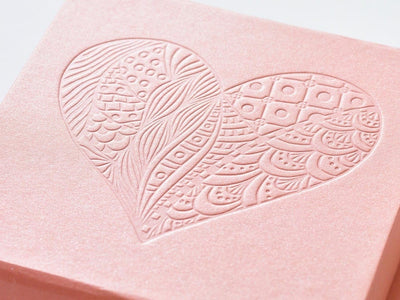 Example or rose gold gift box with custom debossed heart design