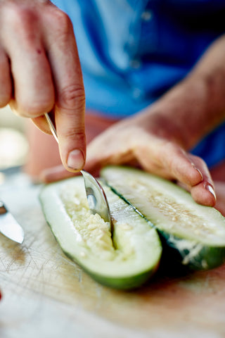 scooping out seeds cucumber