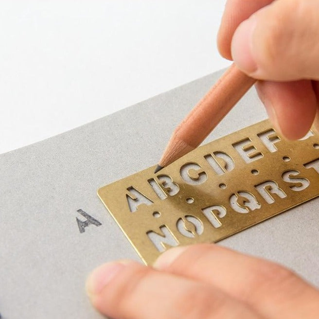 brass template bookmark in alphabet by traveler's company at eyes open project