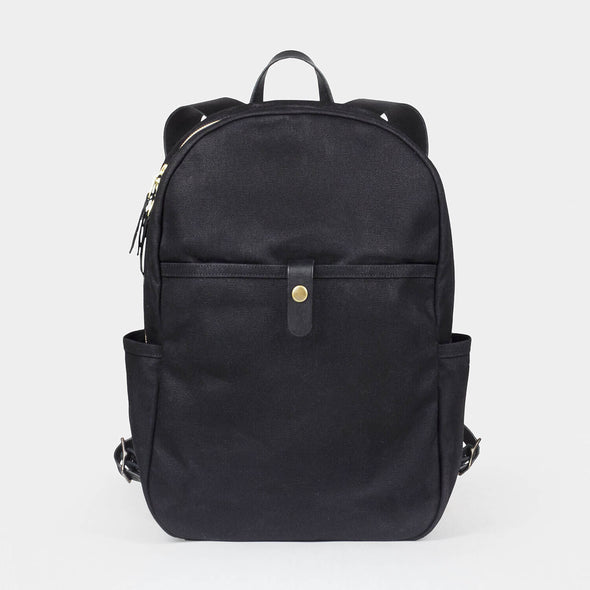Backpack waxed canvas eyes open