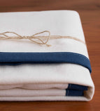 Ivory Flannel Baby Blanket with Navy Trim