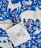 Whimsical Receiving Blanket in Blue, Ivory, and Orange