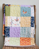 colourful patchwork squares baby quilt